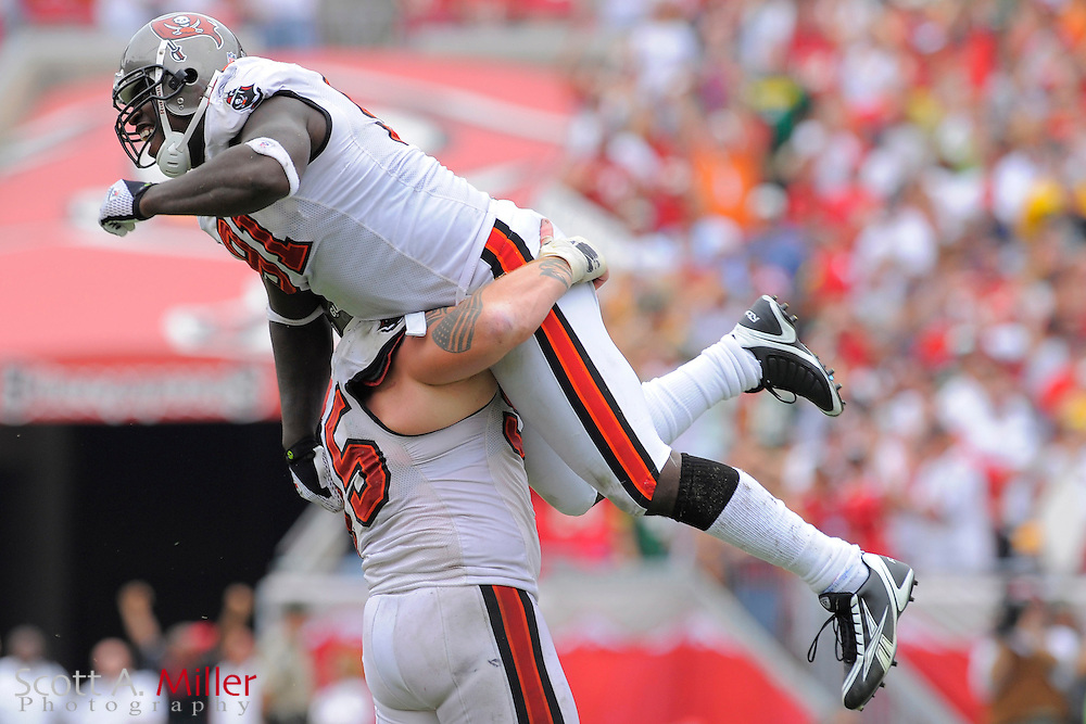 Tampa, Florida, Sept. 28, 2008: Tampa Bay Buccaneers defensive end Greg White (91) and defensive tackle Chris Hovan (95) celebrate in the Bucs game against the Green Bay Packers at Raymond James Stadium. ...©2008 Scott A. Miller
