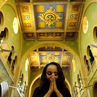 Khartoum, Sudan 21 April 2010 <br /> A christian Sudanese woman prays in a Church of Khartoum.<br /> Photo: Ezequiel Scagnetti