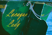 "356204-1126 ~ Copyright: George H. H. Huey ~ Name on transom of ""Lucayan Lady"". ""A"" class Bahamian sloop. Bahamas."