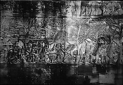 Bas-reliefs on the walls of Bayon. The carvings show scenes of everyday life ? market scenes, cockfighting, chess games and childbirth.