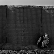 Jul 18, 2008 - Zhari District, Kandahar Province, Afghanistan - A detainee captured by the Afghan Army on a joint patrol with Canadian troops sits by a wall at a Canadian Forward Operating Base in Howz E Madad in Zhari District, Kandahar Province, Afghanistan. .(Credit Image: © Louie Palu/ZUMA Press)