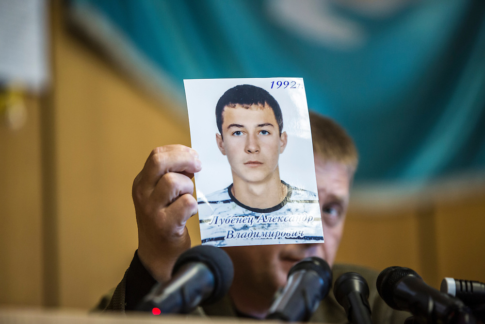 SLOVYANSK, UKRAINE - APRIL 24:  Vyachislav Ponomaryov, the self-appointed pro-Russian separatist mayor of the city of Slovyansk, holds a photo of a young man who was killed earlier in the day while guarding a checkpoint in the city during his daily news conference on April 24, 2014 in Slovyansk, Ukraine. Pro-Russian activists have been occupying government buildings and demanding greater autonomy in many Eastern Ukrainian cities in recent weeks, prompting the government in Kiev to threaten military action to retake control of the cities. (Photo by Brendan Hoffman/Getty Images) *** Local Caption *** Vyachislav Ponomaryov