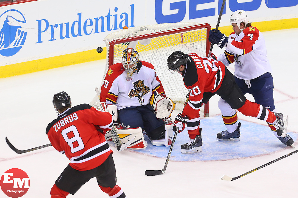 Mar 31, 2014; Newark, NJ, USA; New Jersey Devils right wing Dainius Zubrus (8) shoots the puck wide of Florida Panthers goalie Dan Ellis (39) during the third period at Prudential Center. The Devils defeated the Panthers 6-3.