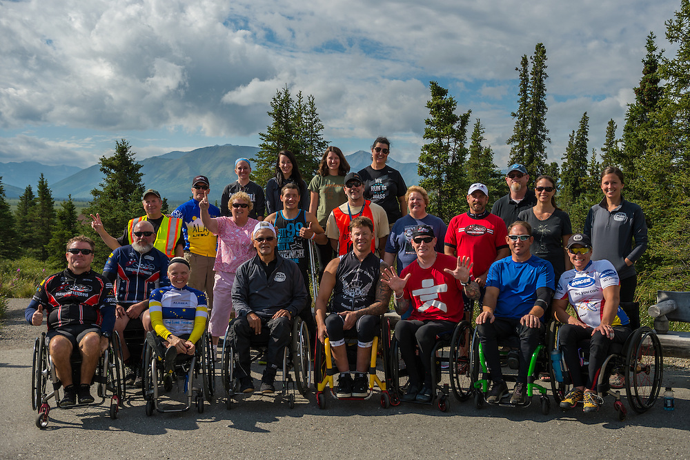 July 25, 2015: Racers and volunteers pose for a group photo following stage five of the 2015 Alaska Challenge handcycle race.