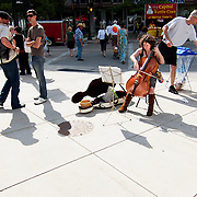 .A musician playing at the farmers market. .The Dane County Farmers Market is held Saturday mornings from early April through early November on the Capitol Square in Madison, Wisconsin.