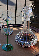 Two wine glasses with liquor decanter.