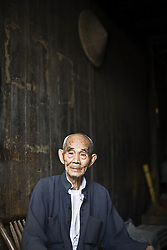 Old man at Daxu Ancient Village at Guangxi Province, China.