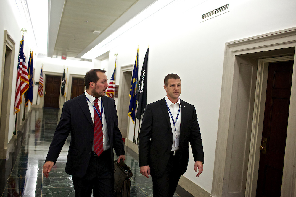 Congressman-elect Markwayne Mullin, from Oklahoma's 2nd District, right, walks with his advisor Trebor Worthen, left, in the Longworth House Office Building in Washington, DC on Nov. 29, 2012.