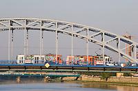 tram seen crossing pilsudski bridge from krakow's kazimierz district to podgorze in sunshine in september 2005