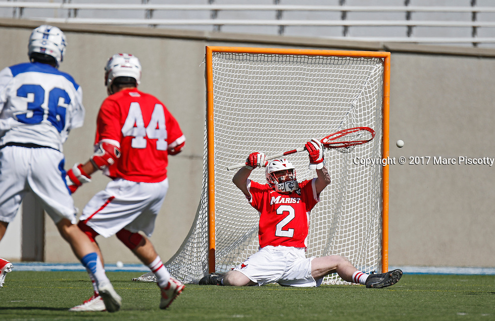 SHOT 2/18/17 12:30:48 PM - Marist College goalie Brian Corrigan #2 makes a save against Air Force during their game at Falcon Stadium at the Air Force Academy in Colorado Springs, Co. Marist won the game 10-4.<br /> (Photo by Marc Piscotty / &copy; 2017)