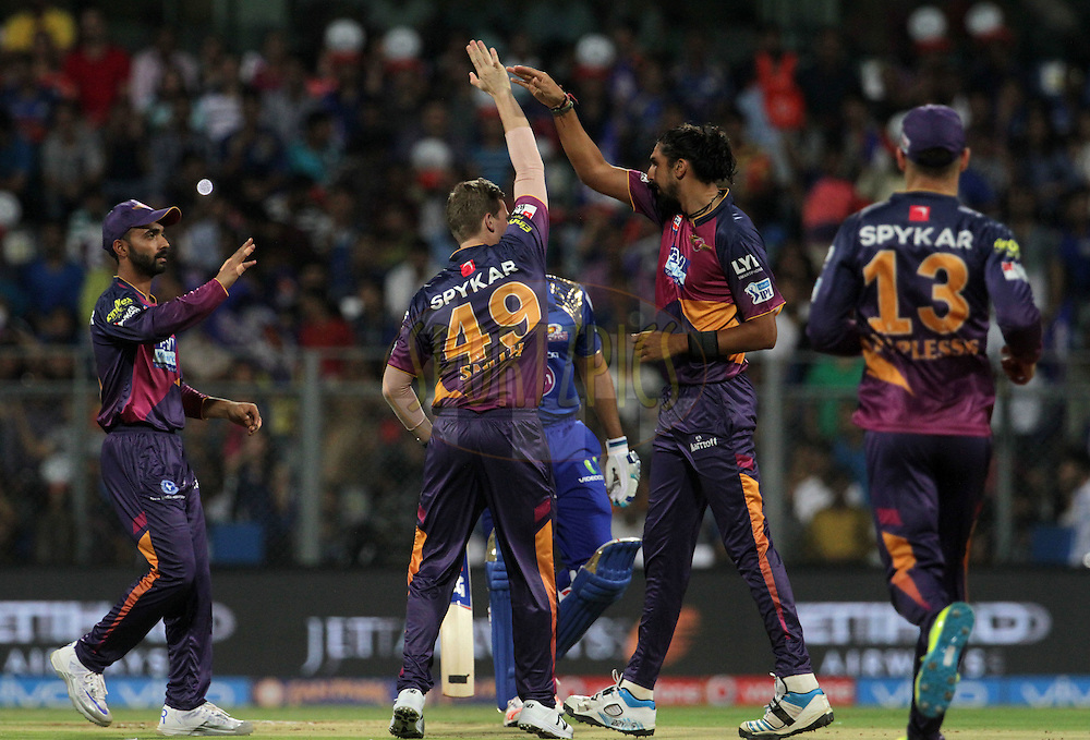 Rising Pune Supergiants players celebrates the wicket of Mumbai Indians captain Rohit Sharma during match 1 of the Vivo Indian Premier League ( IPL ) 2016 between the Mumbai Indians and the Rising Pune Supergiants held at the Wankhede Stadium in Mumbai on the 9th April 2016<br /> <br /> Photo by Vipin Pawar/ IPL/ SPORTZPICS