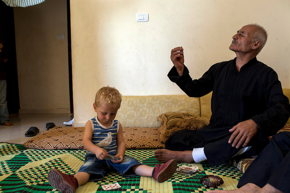 """05/07/2013 near Damour, Lebanon: 70-year old Abu Said sits with Khaled, his grandson. """"Syria was the pearl of the Arab world before this war"""", he lamented. Syrians in Lebanon have been dealt an awful hand, with little access to aid, high unemplyment and overpriced apartments. Estimates have placed the number of Syrian refugees in Lebanon at well over 500,000 people."""