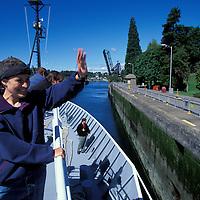 USA, Washington, Seattle, UW Oceanography grad student waves from R/V Thomas G. Thompson leaving port