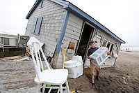 Pete Duhamel of South Kingstown, Rhode Island helps a friend (not pictued) remove his personal items from his cottage after it was damaged by Hurricane Sandy storm surge at Roy Carpenter Beach in South Kingstown, Rhode Island on October 30, 2012.   The area was one of the hardest hit by the storm surge from Hurricane Sandy.  UPI/Matthew Healey