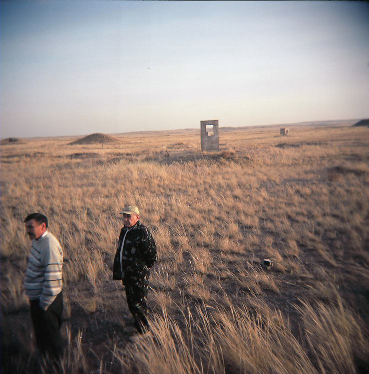 CREDIT: DOMINIC BRACCO II..SLUG:PRJ/KAZAKHSTAN SHEEP HERDERS..DATE:10/21/2009..CAPTION:Two men walk at the Polygon nuclear test sie. The herders live near a radio active lake which was made during the 1970s as part of an experiment by the USSR to create lakes from atomic bombs. The lake is in an area known as The Polygon, a test site for more than 400 of the Soviet Union's nuclear weapons.
