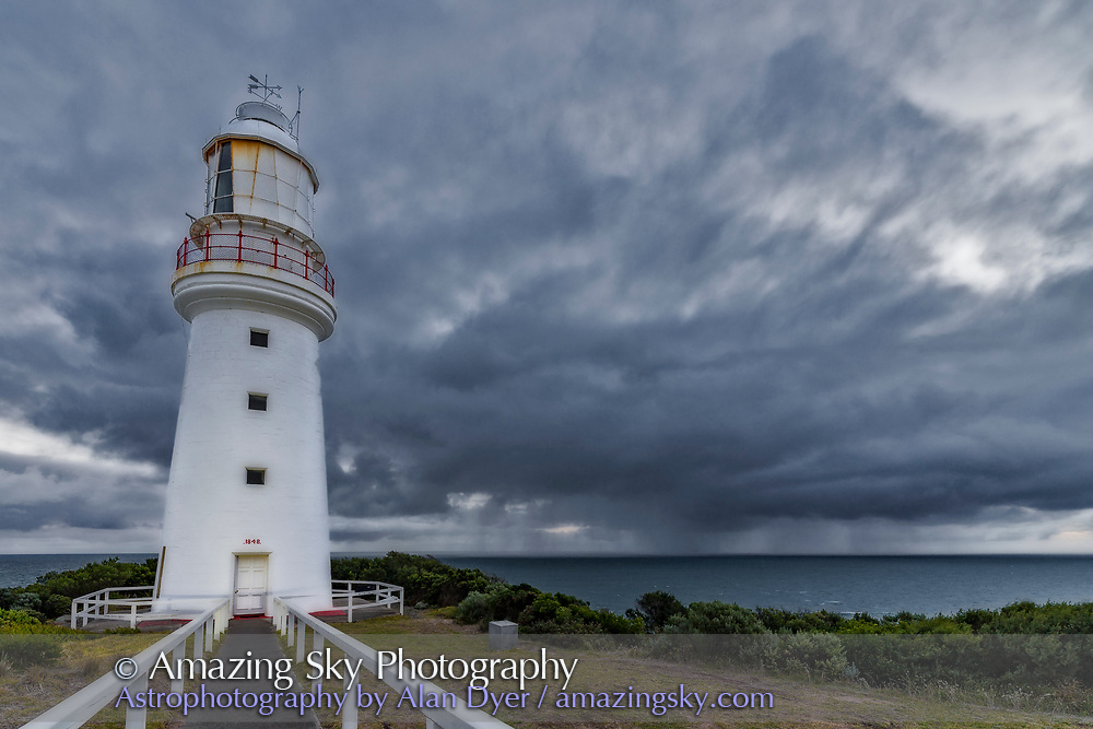 Rain clouds off shore and a stormy sky at Cape Otway Lighthouse, on the Great Ocean Road, Victoria, Australia. <br /> <br /> This is a single exposure with the 14mm lens with a B&amp;W filter applied in modest measure to the sky and ground to mute the colours. A mild Orton effect layer added to soften the details for a dreamy look. The Lighthouse is also illuminated by a spotlight.