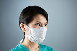 A portrait series representing the intense emotions that Doctors face.  A Japanese female Doctor wearing a white surgical mask, and green medical scrub suit shown.