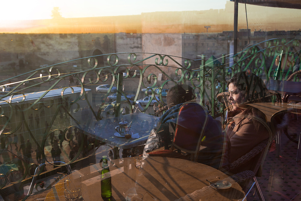 """Meknes, March 2015. A young couple discusses on the terrace of a cafe in Meknes. In the tradition of the Islamic countries, the concept of """"engagement"""" exists only as a brief period before the marriage, in which the parties have already signed the agreement. In the majority of traditional families is very difficult that they accept a free relationship of two youths."""