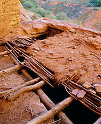 0111-1057 ~ Copyright:  George H. H. Huey ~ Original roof detail of mud and willows, at Anasazi Keet Seel cliff dwelling.  Occupied A.D. 1200's, with over 150 rooms.  Navajo National Monument, Arizona