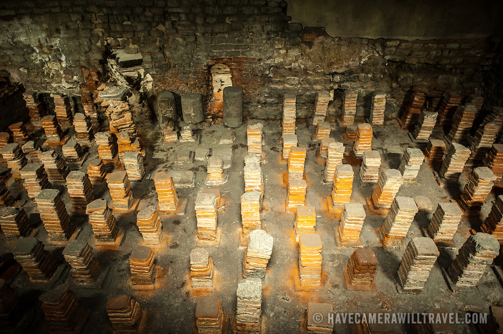 Stacks of clay tiles make up the caldarium of the Roman Baths of Bath in Somerset. The tiled towers allowed steam to heat a lay of flooring that was placed on top of them.