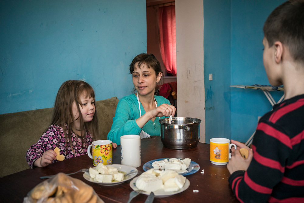 Olga Anisimova, 33 (center), who fled from Yalta on the Crimean peninsula, with her children Nastia, 3 (left) and Maksim, 6, on Tuesday, April 28, 2015 in Dubliany, Ukraine. The Russian takeover of Crimea forced Anisimova and her family to flee to the suburb of Lviv, where she has started a business selling home-made fresh cheese, though her hope is to move to Slovakia. CREDIT: Brendan Hoffman/Prime for the Wall Street Journal UKRMIGRATION
