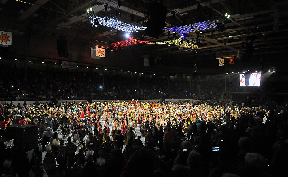jt042817g/a sec/jim thompson/ The floor of Tingley Coliseum is packed with hundreds of dancers for  the Grand Entrance of the 2017 Gathering of Nations Pow-Pow.    Friday April 28, 2017. (Jim Thompson/Albuquerque Journal)