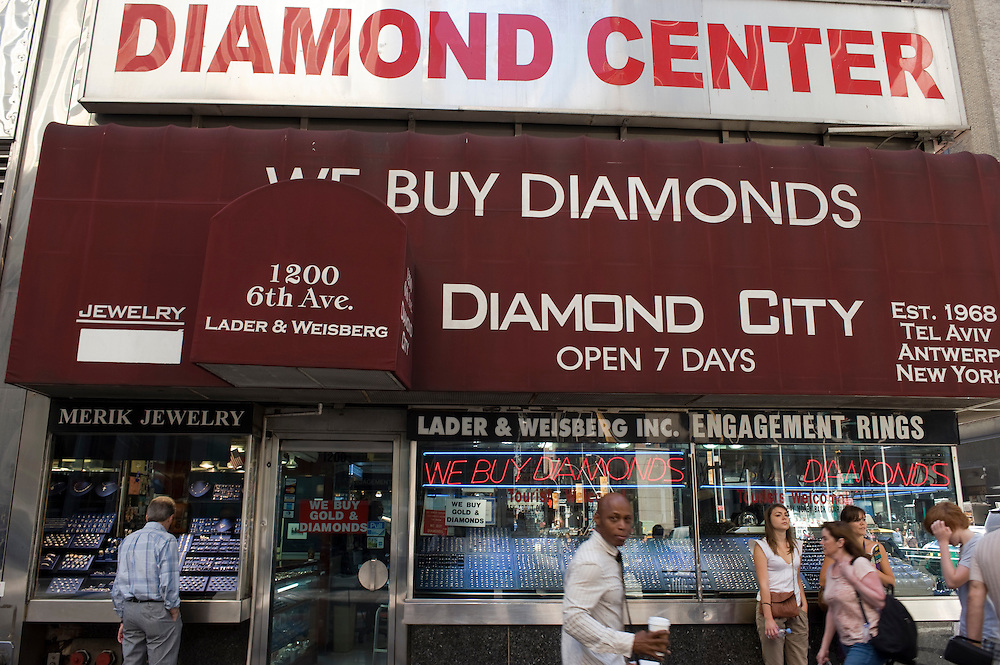 The Diamond Center on 6th Avenue and 47th street..Diamond District New York on 47th street between 5th and 6th avenues in midtown Manhattan . The Diamond District is the world's largest shopping district for all sizes and shapes of diamonds and fine jewelry. Many suppliers and jewelry makers also have their stores and workshops right on 47th street.