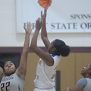 Caesar Rodney Alissa Haith (21) attempts a outside jump shot as Hodgson Vo-Tech Mercedes Baskerville (22) defends during a Diamond State Classic game Wed. Dec. 28, 2016 at Saint Elizabeth's High School in Wilmington.