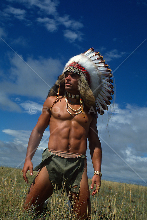 Shirtless American Indian In Tall Grass In New Mexico