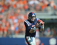 Ole Miss quarterback Bo Wallace (14) catches a pass from Ole Miss' Randall Mackey (1) on a flea flicker and scores vs. Auburn at Vaught-Hemingway Stadium in Oxford, Miss. on Saturday, October 13, 2012. ..