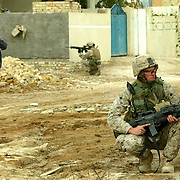 6 December 2004.Yusifiyah, Iraq.Fox Company/Yusifiyah..US Marines of 'Fox Company' patrol the streets of Yusifiyah in North Babel provine Iraq on the 6th December. Both the buildings and the population of the town bear scars from the ongoing battle for control of this area. The Marines are experiencing a lull in attacks against them but predict that the anti-coalition insurgents are biding their time. Meanwhile the US Forces maintain a presence on the streets where they experience a mixed welcome.