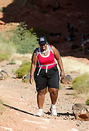 Guest Stacey Scott takes her first hike from the Biggest Loser Resort in Ivins, Utah September 6, 2010.  Guests at the resort affiliated with the popular reality television show hike for miles each day, are restricted to a daily 1,200 calorie diet and exercise 6 to 7 hours a day.  REUTERS/Rick Wilking (UNITED STATES)
