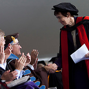 10/21/2011- Medford/Somerville, Mass. - Sally Shuttleworth, Professor of English Literature at Oxford University, shakes the hand of her former colleague Tufts President Anthony Monaco at his inauguration as the University's 13th president on Oct. 21, 2011. (Kelvin Ma/Tufts University)