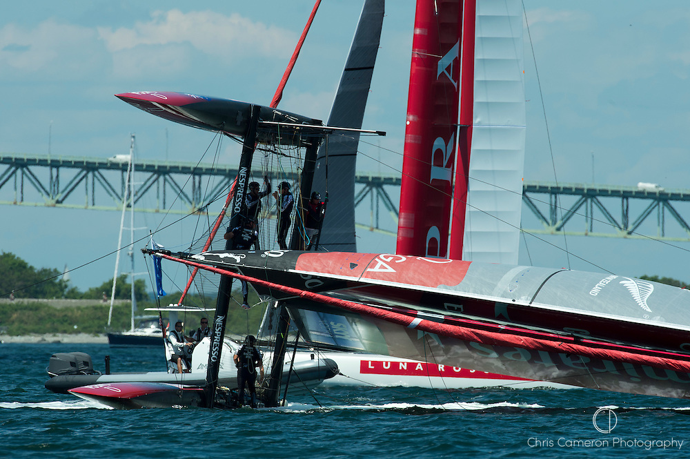 Emirates Team New Zealand capsizes at the first top mark in their first match race against Luna Rossa Piranha. America;s Cup World Series Regatta in Newport, Rhode Island, USA. 28/6/2012
