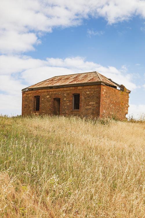 dilapidated old brick farm house in a field near Pallamana, South Australia, Australia