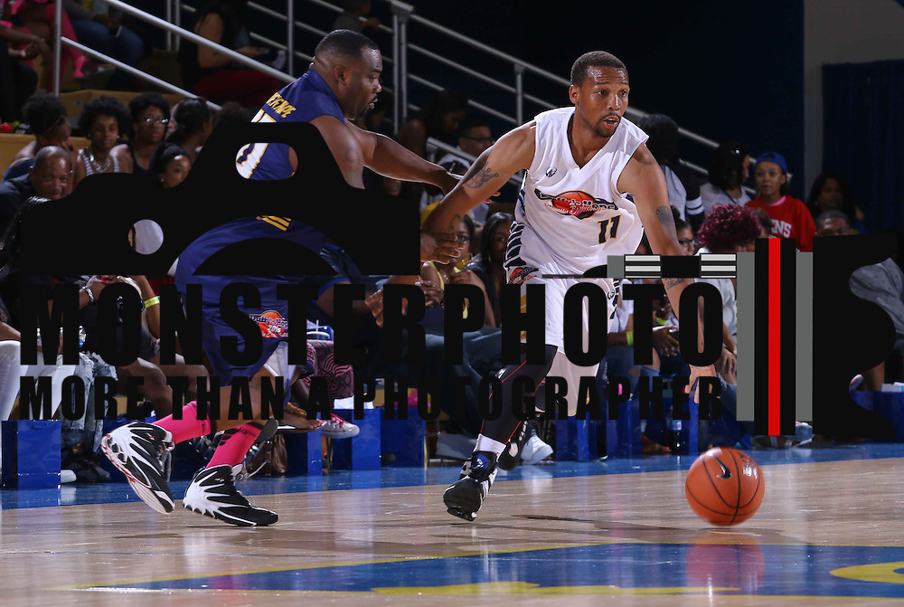 Street baller Brain Smith (11) dribbles past defender John Savage (20) in the second half of The 2015 Duffy's Hope Celebrity Basketball Game Saturday, August 01, 2015, at The Bob Carpenter Sports Convocation Center, in Newark, DEL.    <br /> <br /> Proceeds will benefit The Non-Profit Organization Duffy's Hope Youth Programming.