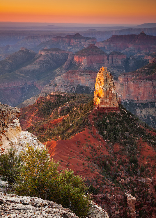 The first rays of daylight provide a warm glow on Mount Hayden. From Point Imperial on the North Rim of Grand Canyon National Park.