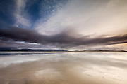 The Braint Estuary at Newborough at low tide. The sky was changing and high cirrus were becoming clouded by altostratus. Rain starts on the horizon. A half moon can be seen high in the frame.<br /> <br /> 3 x A1 Editions - SOLD OUT <br /> 30 x A2 Editions