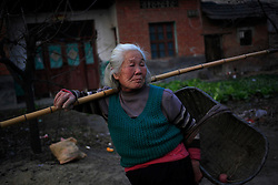 Chinese villager Wang Xinyu of Xiangnan Village walks home with an empty basket as produce from farmland are badly affected by pollution from a nearby chemical plant in Zekou Town, Qianjiang City of Hubei Province, China 14 January 2013. While the heavy smog in Beijing and much of northern China in recent days have caused alarm among residents and renewed scrutiny on the pollution woes of the country, villagers in a small town of Hubei Province have been grappling with severe air, water and noise pollution on a daily basis over the past two years. China's Xinhua news reported 04 January 2013 that more than 60 cancer deaths in various villages of Zekou Town has been caused by the heavy pollution from the chemical industry park nearby. About 20 or more chemical plants built around the villages of Dongtan, Xiangnan, Zhoutan, Sunguai, Qingnian and others over the past two years has created huge increases in noise, air and water pollution. Many villagers complained of intensifying respiratory, heart, skin and circulatory illnesses caused by the pollution and a large spike in cancer diagnoses and deaths since the factories were built. .