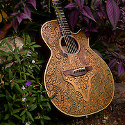 Brandon Thomas's customized his guitar by artfully carving this unique scroll design into the face of his Takamini guitar.