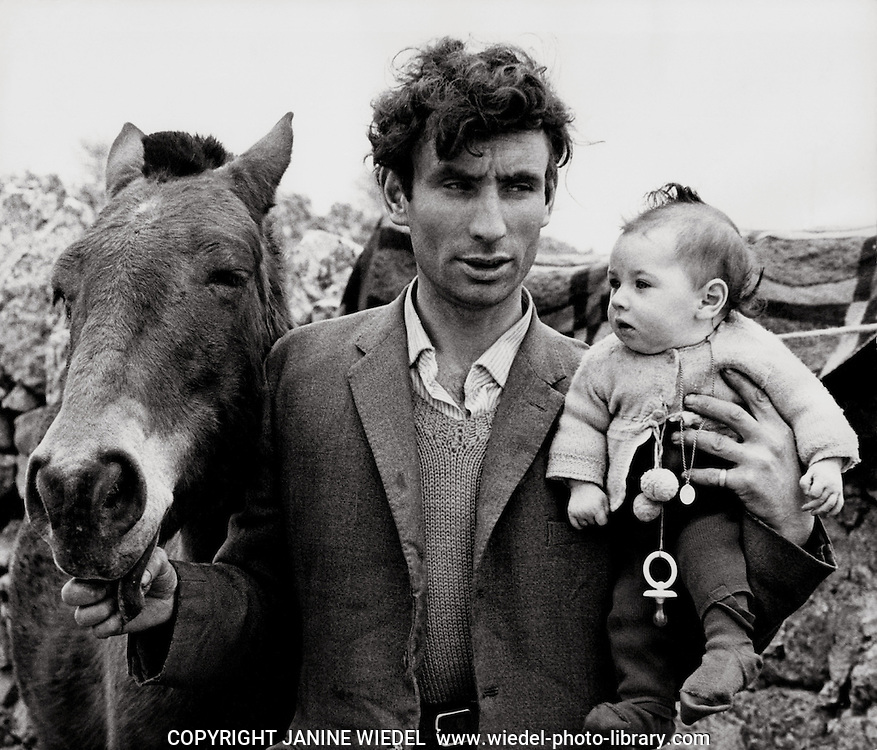 Irish Tinker Traveller with horse and baby in Ireland