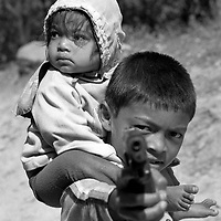 A young boy threaten me with a toy gun.