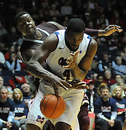 "Mississippi's Demarco Cox (4) and Mississippi State's Renardo Sidney (1) go for the ball at the C.M. ""Tad"" Smith Coliseum in Oxford, Miss. on Wednesday, January 18, 2012. Mississippi won 75-68. (AP Photo/Oxford Eagle, Bruce Newman)."