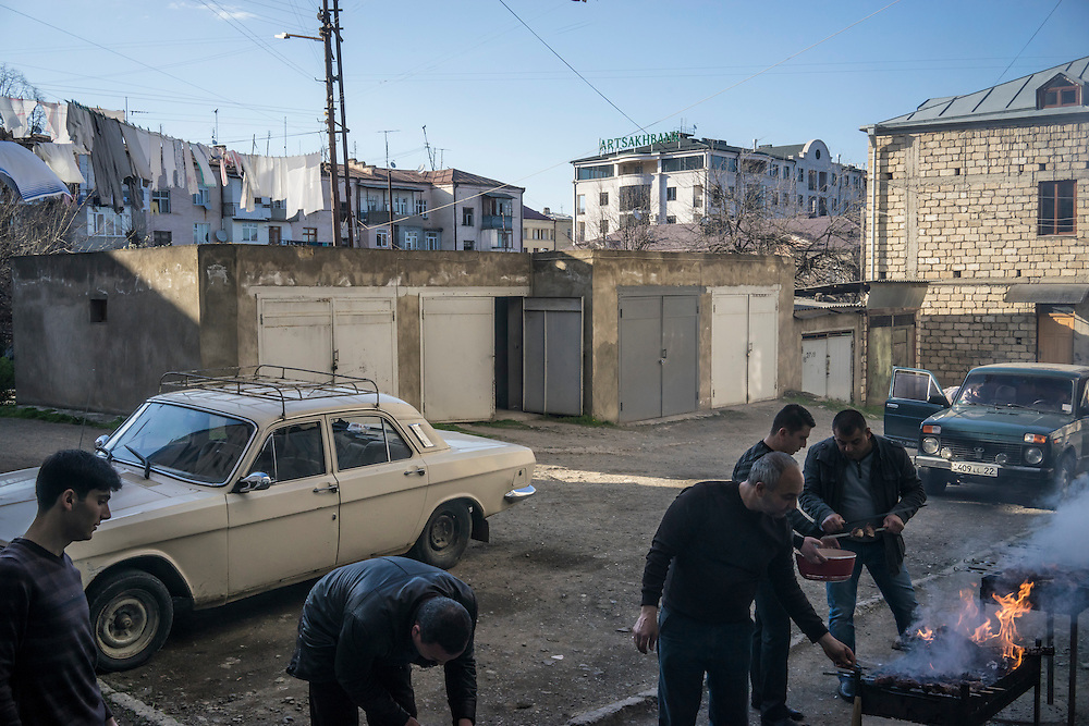 STEPANAKERT, NAGORNO-KARABAKH - APRIL 17: Men cook shashlik, or grilled meat, to celebrate one of the men's wife's birthday and his son's marriage on February 21, 2015 in Stepanakert, Nagorno-Karabakh. Since signing a ceasefire in a war with Azerbaijan in 1994, Nagorno-Karabakh has functioned as a de facto part of Armenia, with hostilities along the line of contact between Nagorno-Karabakh and Azerbaijan occasionally flaring up and causing casualties. (Photo by Brendan Hoffman/Getty Images) *** Local Caption ***