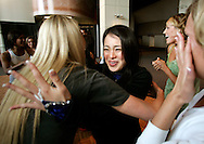 Kaoruko Horiike of Tokyo, Japan is congratulated by other Denver Broncos cheerleaders after she made the team in Denver, Colorado March 25, 2007.  Over 250 women applied for the 34 slots with Horiike being one of them.  REUTERS/Rick Wilking (UNITED STATES)