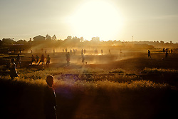 A dusty sunset beside Kibera, one of the largest Africa's slum that takes place inside Nairobi city.