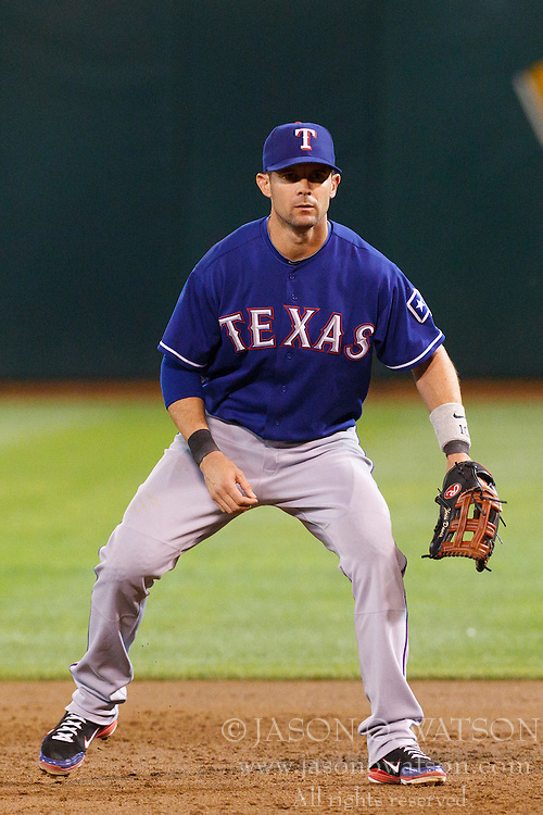 September 20, 2011; Oakland, CA, USA;  Texas Rangers first baseman Michael Young (10) stands in the infield during the second inning at O.co Coliseum.  Texas defeated Oakland 7-2.