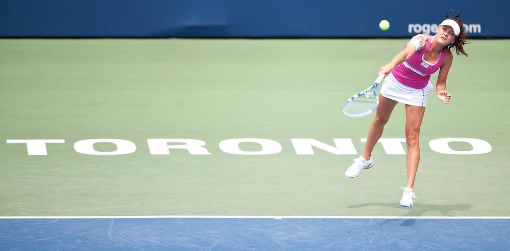 Agnieszka Radwanska serves during her semi-final match against Samantha Strosur at the Rogers Cup WTA event in Toronto, Ontario, August 14, 2011. Strosur defeated Radwanska in 3 sets.<br /> AFP PHOTO/Geoff Robins