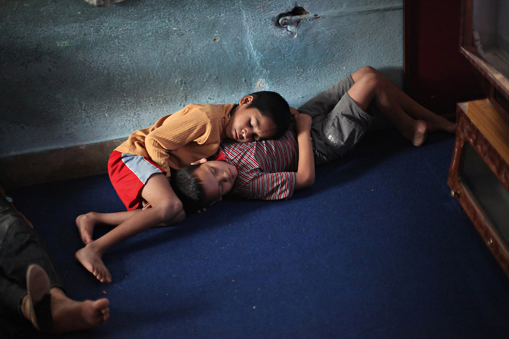 Burn - Support - Naina Dhakal, 12, and Umesh Shahi, 8, doze off in the TV room of the Disabled Newlife Centre in Kathmandu, Nepal. Shahi's right foot was amputated after receiving severe burns from a cooking fire.