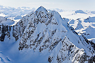 Summit of mountain with icefield in background, one of dozens in the Chugach Mountains in Chugach State Park near Anchorage in Southcentral Alaska. Morning. Spring.